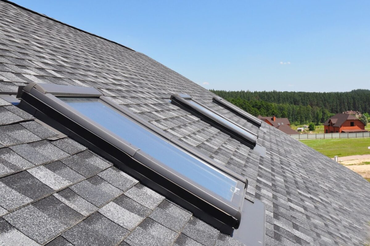 skylights on a shingle roof during a clear and sunny day
