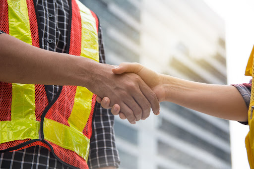 roofer shaking hands with a client